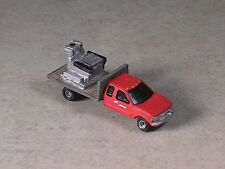 N Scale 2004 Flat Bed Pickup Truck with red cab with equiptment load on back.