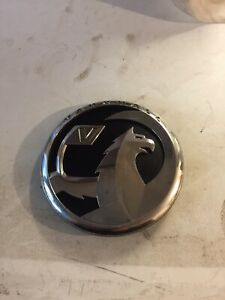 VAUXHALL ASTRA J GENUINE FRONT GRILL BADGE WITH ADAPTER 13294635