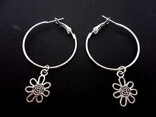 A PAIR OF SILVER PLATED  30MM HOOP & FLOWER CHARM  EARRINGS. NEW.