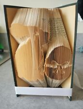 Folded Book Art. Easter bunny and easter egg. Religous. Easter.