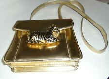 Striking gold color purse with exotic Zebra closer