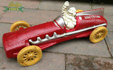 Cast Iron Waving Michelin Man Racer in Red Racing Car Moving Wheels Ornament