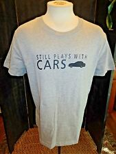 "MENS GREY ""STILL PLAYS WITH CARS"" GRAPHIC T SHIRT SIZE LARGE / SO CUTE"