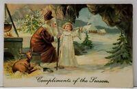 1905 Santa Claus Brown Robe Father Christmas Deer Angel in Cave Emb Postcard F15