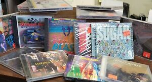 30 CD Bulk Lot..New still sealed...mixed artists and genres