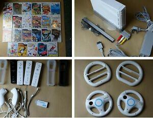Huge Nintendo Wii bundle - 23 Games, 4 Remotes, 4 wheels, 2 nun chucks, HDMI out