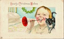 Postcard~Hearty Christmas Wishes~Child Blowing Horn~Cat~Vintage~Posted 1918