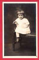 RPPC GIRL ON BENCH HOLDING WOOD TOY RP POSTCARD  CUTE !  HELENE 3 YRS OLD