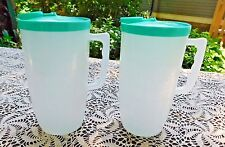 TWO VINTAGE 1950's / 60's TURQUOISE LID PLASTIC JUICE PITCHERS w MEASURES on SID