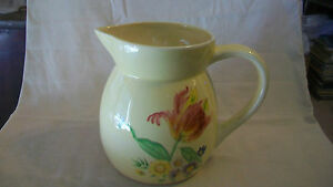 CERAMIC YELLOW WATER PITCHER WITH HAND PAINTED FLOWERS
