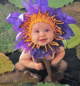 """550 Piece ANNE GEDDES Jigsaw Puzzle """"Baby In Lily Pads"""" used"""