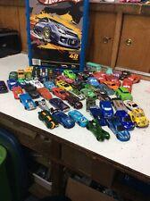 HOT WHEELS 48 CAR HOLDER WITH 62 CARS,DISNEY, MAISTO,HOT WHEELS, MATCH BOX