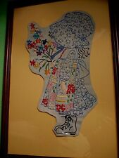 Vintage EMBROIDERY ART of a little GIRL with colorful FLOWERS on blue jeans.
