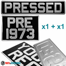 PAIR OLD STYLE PRE 76 OBLONG SQUARE BLACK AND SILVER PRESSED METAL NUMBER PLATES