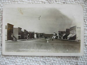 RPPC-LAKE ANDES SD-MAIN STREET WEST-STORES-SOUTH DAKOTA-REAL PHOTO-CHARLES MIX