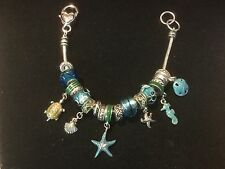 "Pre Owned Silver-like 8"" Bracelet with turquoise charms.  Seashell Theme."