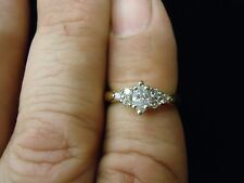 14K YELLOW GOLD MARQUISE DIAMOND RING WITH ROUND ACCENTS APROX .50 CTTW