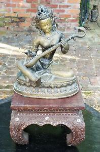 SEMI ANTIQUE BRONZE THAI RATTANAKOSIN BUDDHA with INSTRUMENT + CARVED WOOD STAND