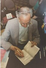 CANDID PHOTO DONALD WOLHEIM SIGNING THE MEN FROM ARIEL