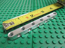 11 unit long aluminum beam with holes on all sides. Works with Lego Technic