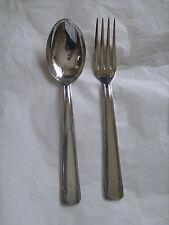 Ensemble composé d'une fourchette et d'une cuillère en métal argenté poinçonné