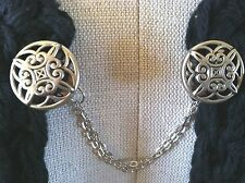 The mattie silver tone plastic Celtic sweater clip