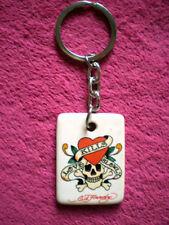 Schlüsselanhänger mit  TOTENKOPF / PIRATEN - MOTIV - LOVE KILLS SLOWLY Spruch