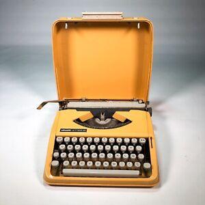 1980s Vintage typewriter OLIVETTI lettera 82 Brazil mustard yellow with case