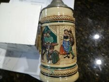 Two antique German Steins one Lidded another Unlidded