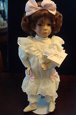 """""""Little Girl with a Curl"""" made by Ashton Drake, new in original box wit stand"""