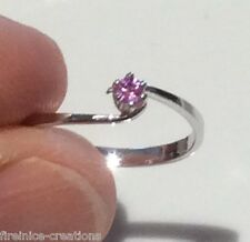 Natural light pink Ruby set in a white gold ring