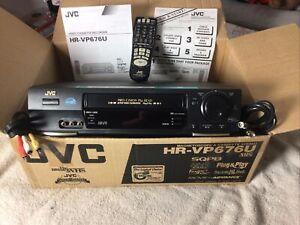 New JVC Video Cassette Recorder HR-VP676U W/ Remote, Original Box, And Manuals.