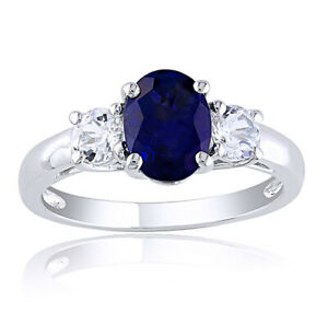 Sterling Silver 2 5/8 CT TW Created Blue Sapphire & White Topaz Three Stone Ring
