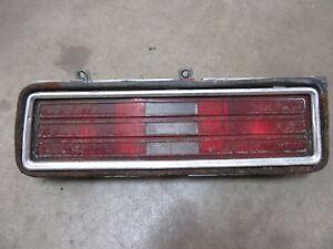 1976 1977 Pontiac Ventura exterior rear tail light lens housing DRIVER side