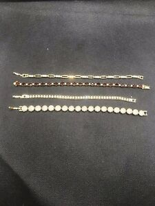 Job lot of 4 gorgeous designer statement style sparkly pretty bracelets