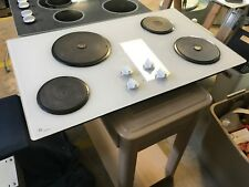 White GE Monogram Glass Cooktop With 4 Solid Disc Burners Model # ZEU6332P1WG
