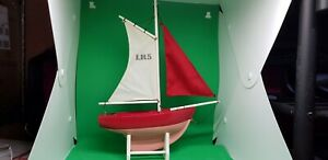 Hand Crafted LR5 1930's wooden red sailboat, by Authentic Models.