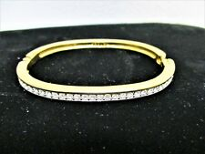 Swarovski Gold Tone Hinged Bangle Bracelet Clear Channel Crystals S.A.L. Signed