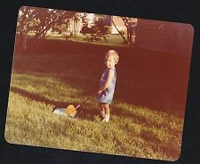 Old Vintage Photograph Adorable Little Boy Mowing Lawn With Toy Lawn Mower 1977