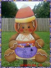 HP wooden Halloween yard stake gingerbread holding a bowl of candies, treats