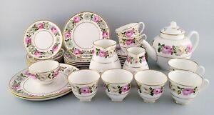 Royal Worcester, England. Complete tea service for seven people in porcelain