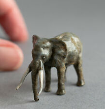 More details for miniature cold painted bronze standing elephant with tusks - signed