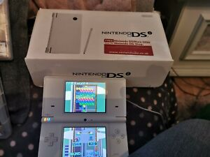NINTENDO DSI White still boxed with charger no games included.