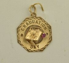 "CW210        14K  YELLOW GOLD  ""GRADUATION "" PENDANT CHARM  WITH A RUBY STONE"