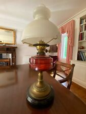 More details for antique working oil lamp with stunning red glass bowl on an ebony base