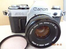 Canon AE-1 SLR Camera black body w/FD50mm/f1.8SC,filter,strap Japan Exc+++2367-1