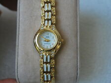 New Q&Q by Citizen Gold Tone Lady Dress Watch w/White Links.