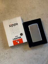 VINTAGE WORKING ZIPPO SLIM 1982 SILVER TONE LIGHTER NO. 1610