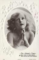 1909 VINTAGE EMBOSSED LILLIES around BEAUTIFUL YOUNG GIRL PRAYING POSTCARD