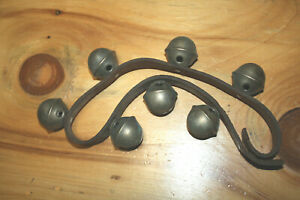 Leather belt with 7 vintage  size  5  brass sleigh bells.  All perfect.  (151)